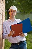 Builder In Hard Hat With Documents