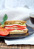 Fresh And Delicious Classic Club Sandwich With Coffee