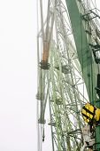 stock photo of derrick  - Derricks Of Port Cranes In The Mist - JPG