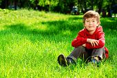 pic of 7-year-old  - Cute 7 years old boy having fun outdoor - JPG