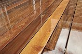 pic of rainy day  - Wet Outdoor Decking Surface On Rainy Day - JPG