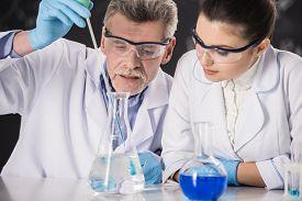 foto of professor  - Senior chemistry professor and his assistant working in laboratory - JPG