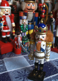 image of tchaikovsky  - a little prince nutcracker with a crowd of international nutcrackers in the background - JPG