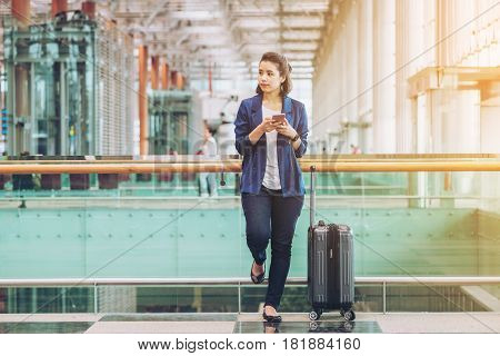 poster of Tourist Woman In The Airport Terminal With Luggage