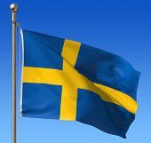 Flag of Sweden against blue sky.