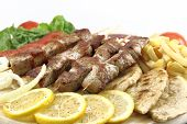 foto of souvlaki  - Plate of traditional Greek pork skewer  - JPG