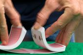 picture of playing card  - dealer shuffling playing cards - JPG