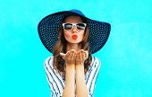 Fashion Portrait Pretty Woman With Red Lips Is Sends An Air Kiss In Straw Summer Hat Over Colorful B poster