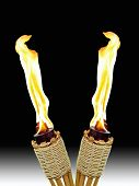 foto of citronella  - two burning tiki torches crossed together on white and black background - JPG