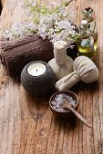 Spa concept with lilac flowers on old wooden . Spa. Spa treatment. Spa massage.  poster