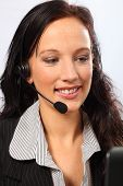 Business Telesales By Smiling Young Woman
