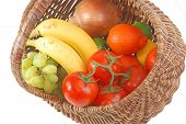 pic of tangelo  - Old fashioned wicker basket filled with fresh fruits and vegetables  - JPG