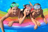 stock photo of swimming pool family  - Happy kids in the pool - JPG