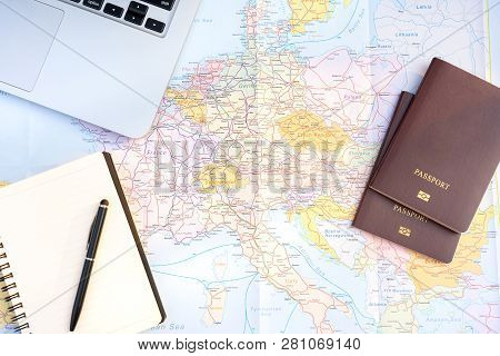 poster of Passport On Europe Map Background.travel Planning.top View Of Traveler Accessories With Two Passport