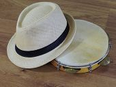 A Pandeiro (tambourine), A Brazilian Percussion Musical Instrument, And A Samba Player (sambista) Ha poster