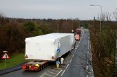 image of oversize load  - Wide load being escorted on a main road in the UK - JPG