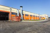 Manufacture Building Of Modern Waste Recycling Processing Plant In Orange Style. Separate Garbage Co poster