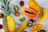 Ripe Juicy Tropical Summer Seasonal Fruits Mango Papaya Pineapple Kiwi Bananas Wood Background. Vaca poster