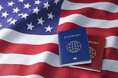 Passports on the flag of the US United Ststes. Getting a visa to USA ,  travel, naturalization and i poster