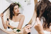 Hair And Body Care. Young Happy Woman In White Towel Applying Conditioner Mask On Hair In Bathroom,  poster