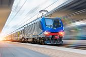 Railway Station With Head Locomotive High Speed Commuter Train With Motion Blur Effect poster