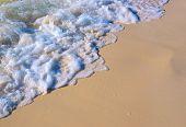 Foamy Sea Tide On White Sand Beach. Sea Tide On Yellow Sand. Tropical Seaside Photo. Marine Holiday. poster