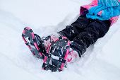 Little Girl snowshoeing snow shoeing shoes in winter having fun poster