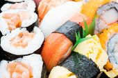 Close Up And Selective Focus Point On Seafood Sushi Japanese Food Style With California Roll Maki ,  poster