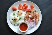 Fried Eggs With Tomatoes, Red Onion, Bacon For Breakfast On A White Plate On The Black Background. D poster