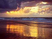 Storm, Sunlight And Majestic Reflection On The Sand