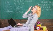 Woman Tired Teacher Work Laptop Classroom Chalkboard Background. Working Conditions For Teachers. Wo poster
