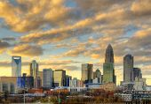 Skyline of Uptown Charlotte, North Carolina under dramatic cloud cover.