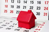 Miniature House On Calendar Pages
