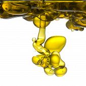Olive oil pouring into water