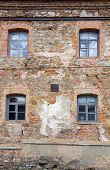 image of carmelite  - Old orange brick wall with four windows in Monastery  - JPG