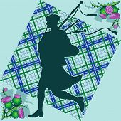 stock photo of bagpipes  - Scottish bagpiper on the background of plaid and thistle flowers - JPG