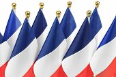 French Flags Hanging On The Gold Flagpole,