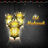 pic of ramazan mubarak  - illustration of illuminated lamp on Eid Mubarak background - JPG