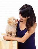 Asian woman with poodle