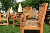 Outdoor wood furniture in grassy backyard