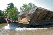 Boat On The Mekong River_