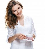 Happy beautiful woman with coffee cup in hands isolated on white