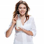Happy beautiful woman with bottle of milk isolated on white