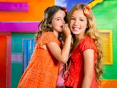 children friends girls whispering ear in vacation at tropical colorful house