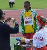 DONETSK, UKRAINE - JULY 11: IAAF Ambassador Ato Boldon hand over silver medal for 3000 m race to Ber