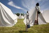 foto of revolutionary war  - A scene of tents set up for War Reenactment as in the Revolutionary War or the War of 1812 - JPG