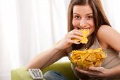 Student Series - Young Woman Eating Potato Chips