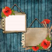 Wooden Background With Paper Card And Poppy