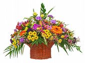 stock photo of carnation  - Colorful flower bouquet arrangement centerpiece in wicker basket isolated on white background - JPG