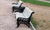 stock photo of banquette  - image of bench in city park at spring - JPG